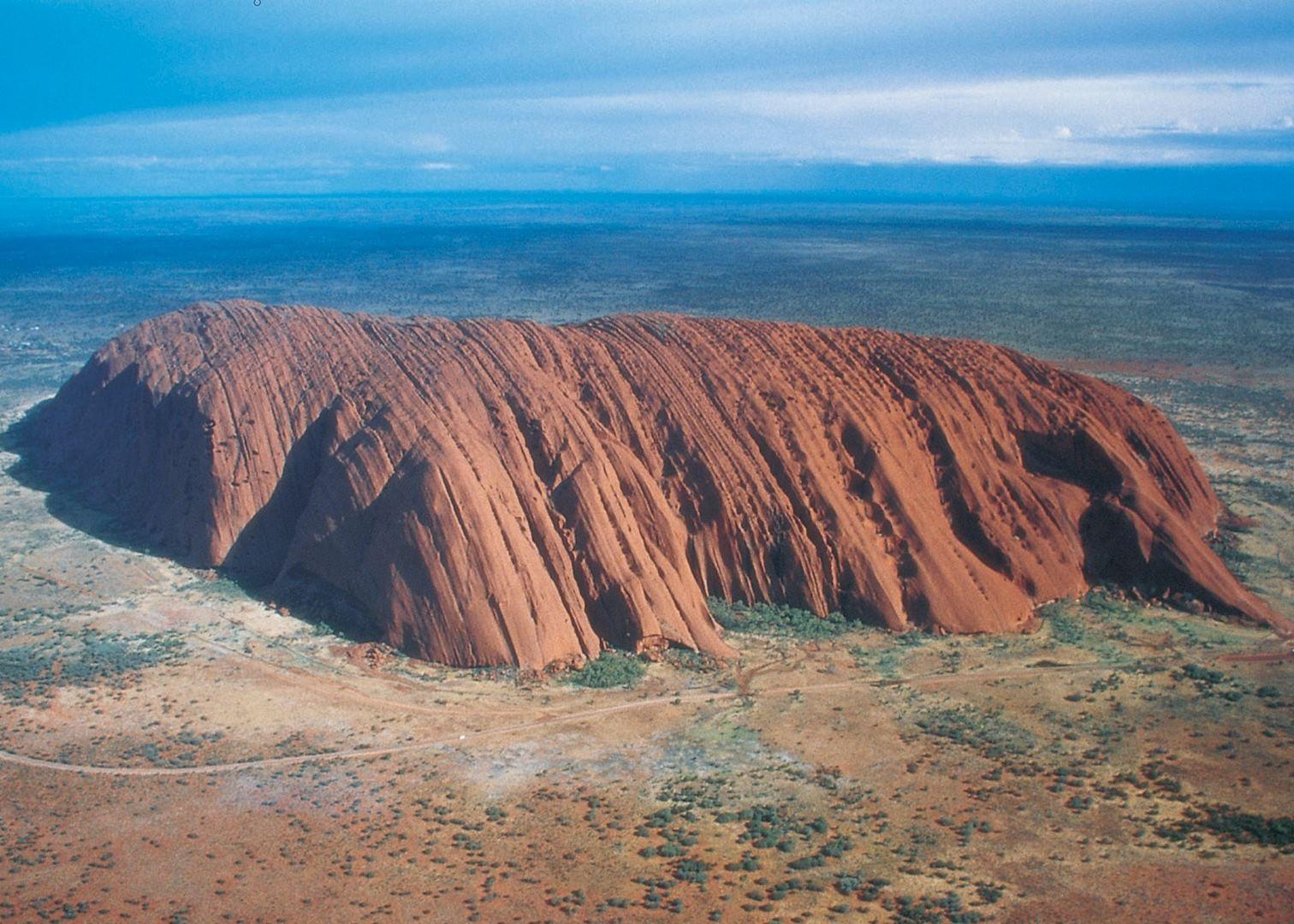 Aerial view of Ayers Rock in Uluru-Kata Tjuta National ... |Uluru Kata Tjuta National Park Australia