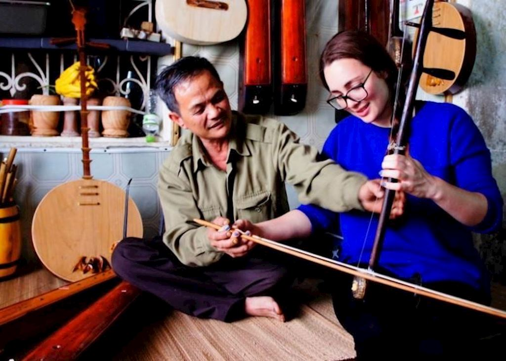 Learning about traditional music in Hanoi