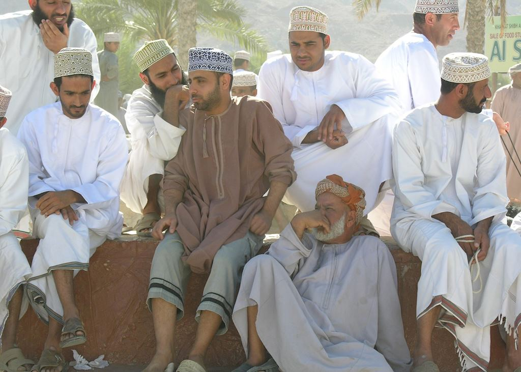 Men at Nizwa cattle market, Oman