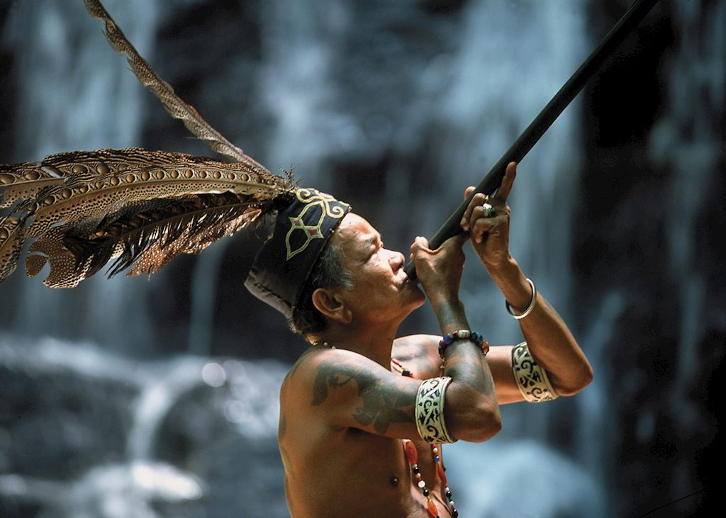 Iban tribesman with blow pipe, Batang Ai, Sarawak