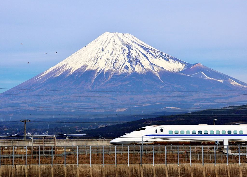 'Shinkansen' bullet train passing by Mount Fuji