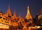 The Shwedagon pagoda shines bright in the evening