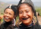 Women of the Ann tribe paint their teeth black