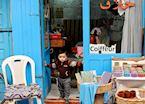 Boy in barber's shop doorway