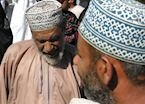 Men at Nizwa cattle market, Oman