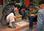 Locals playing a board game, Hanoi