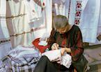 Ukrainian lady with needlework, Lvov, Ukraine