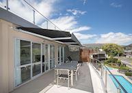 Balcony overlooking pool