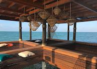 Day beds on the dock at Jaguar Reef