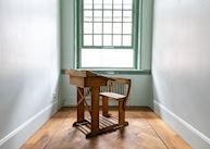 An antique school chair and desk