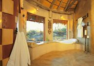 A bathroom with a view at the Okonjima Bush Suite, Central Highlands