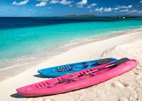 Kayaks on the beach, Palm Island Resort & Spa, Palm Island
