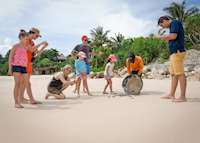Releasing baby Turtles, Nihiwatu Resort, Pantai Nihiwatu