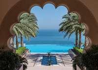 Al Husn pool through courtyard arch, Shangri-La Al Husn Resort & Spa, Muscat