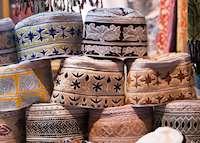 Men's caps in souq, Muscat