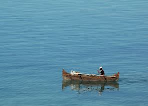 Fisherman in a pirogue off Nosy Komba