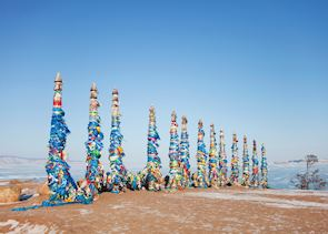 Columns with colorful ribbons on Cape Burhan