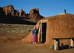 Navajo woman with hogan, Monument Valley