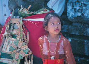 Balinese girl outside a temple