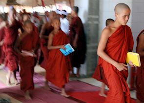 Novice monks walk to exams in the grounds of a temple at Nyaung Shwe