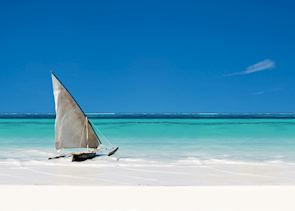 Dhow boat in the crystal blue waters of Zanzibar