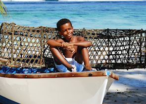 Local boy in a fishing boat