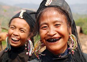 Women of the Ann tribe paint their teeth black