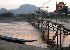 Riverside Bar and Bamboo Walkways at Sunset; Vang Vieng, Laos