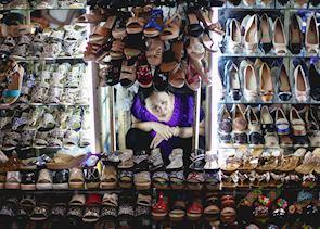 Shoe seller at a Saigon market