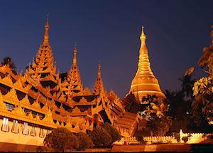 The Shwedagon pagoda shines bright in the evening