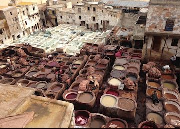 Men working in the various stages of the tanneries of Fez