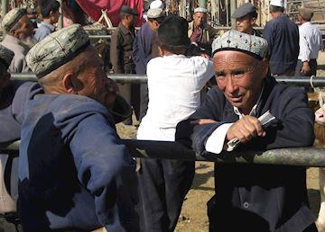 Uighur men, Kashgar Sunday market