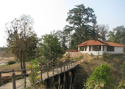 A small bridge leading to the main lounge and dinning area at Flame of the Forest, Kanha