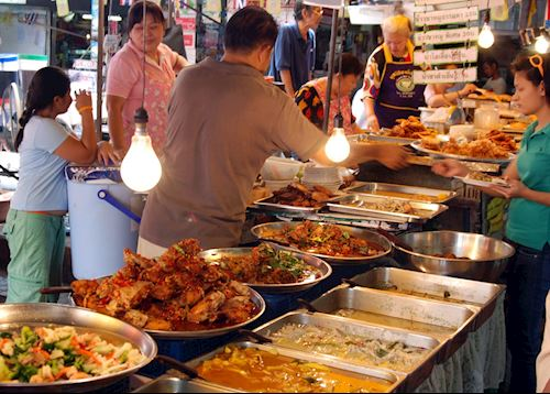 Freshly cooked food at street stalls in Bangkok