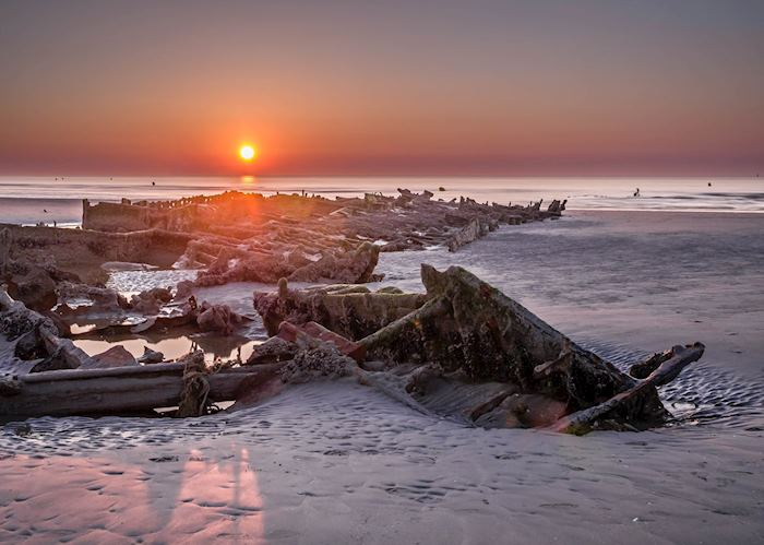 Sunset with exposed shipwreck Crested Eagle from World War II