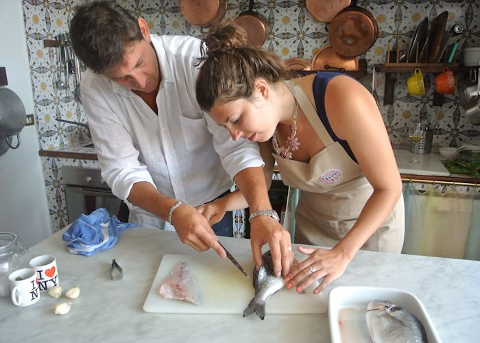 Filleting fish at Casa Laura's cooking class