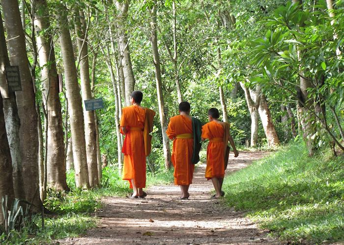 Monks walking by Mount Phousi