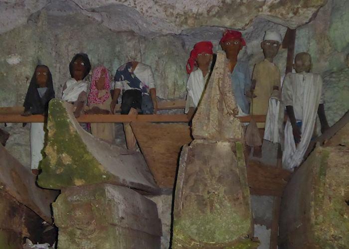Tau-taus inside the cave of Tampangallo