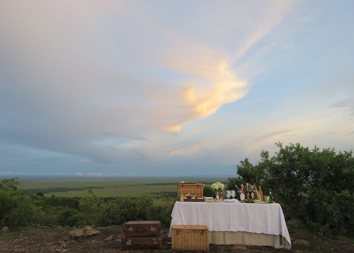 Sundowners looking over the Masai Mara from Bateleur Camp