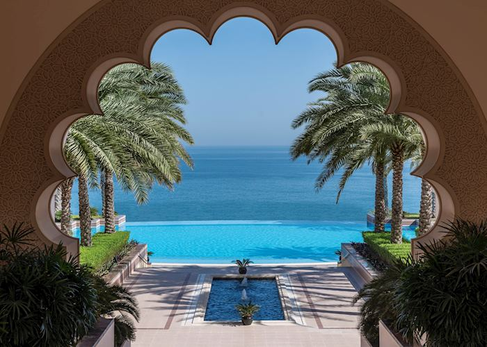 Al Husn pool through courtyard arch, Shangri-La Al Husn Resort & Spa, Muscat