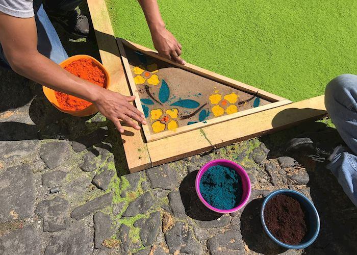 Locals creating their 'alfombra' during Semana Santa