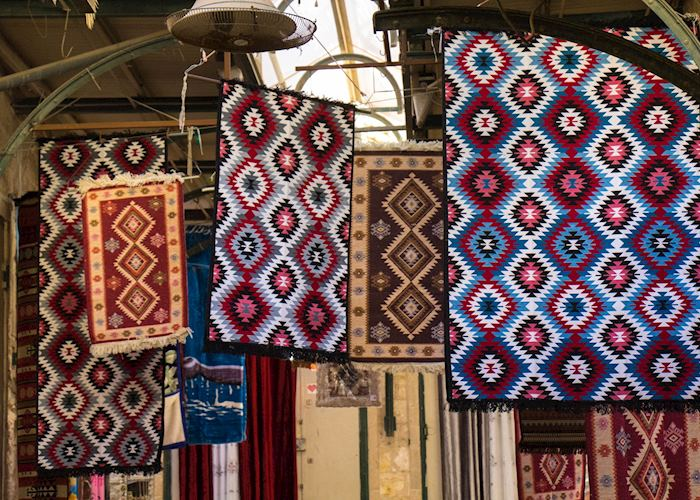 Rugs for sale in a Souk market, Nazareth