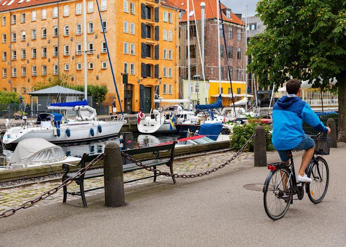 Biker passing Copenhagen canal