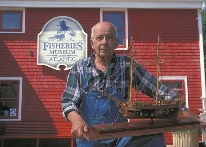 Model ship builder outside the Fisheries Museum of the Atlantic, Lunenburg
