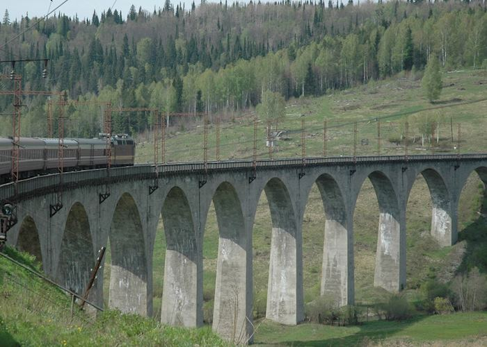 Trans-siberian train crossing a bridge