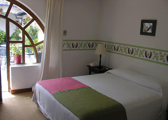 Esculolio room with private garden, Hacienda Zuleta
