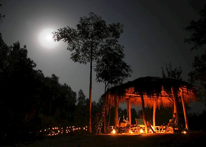Guests enjoying the campfire during their stay at Shergarh