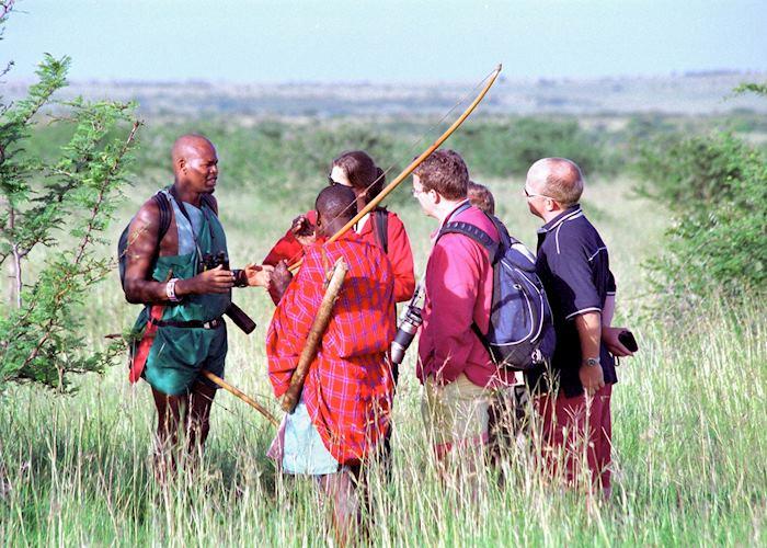 Rekeros Jackson walking with guests, Rekero Tented Camp