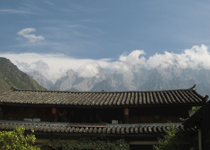 Jade Dragon Mountain over the rooftops on the Tiger Leaping Gorge trek