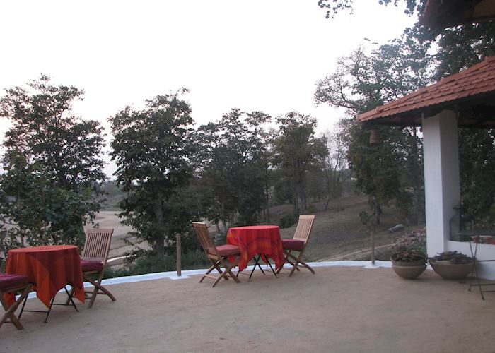 Mud plastered decking offering wonderful views of the Banjaar River from Flame of the Forest, Kanha